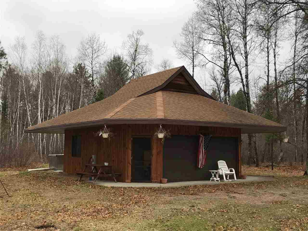 View Single-Family Home For Sale at W8104 HOLMES JUNCTION ROAD, Pembine, WI
