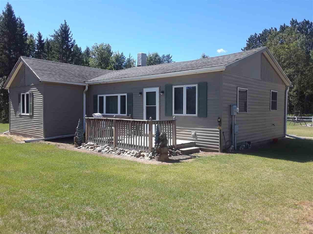 View Single-Family Home For Sale at 10111 PESHTIGO BROOK ROAD, Suring, WI