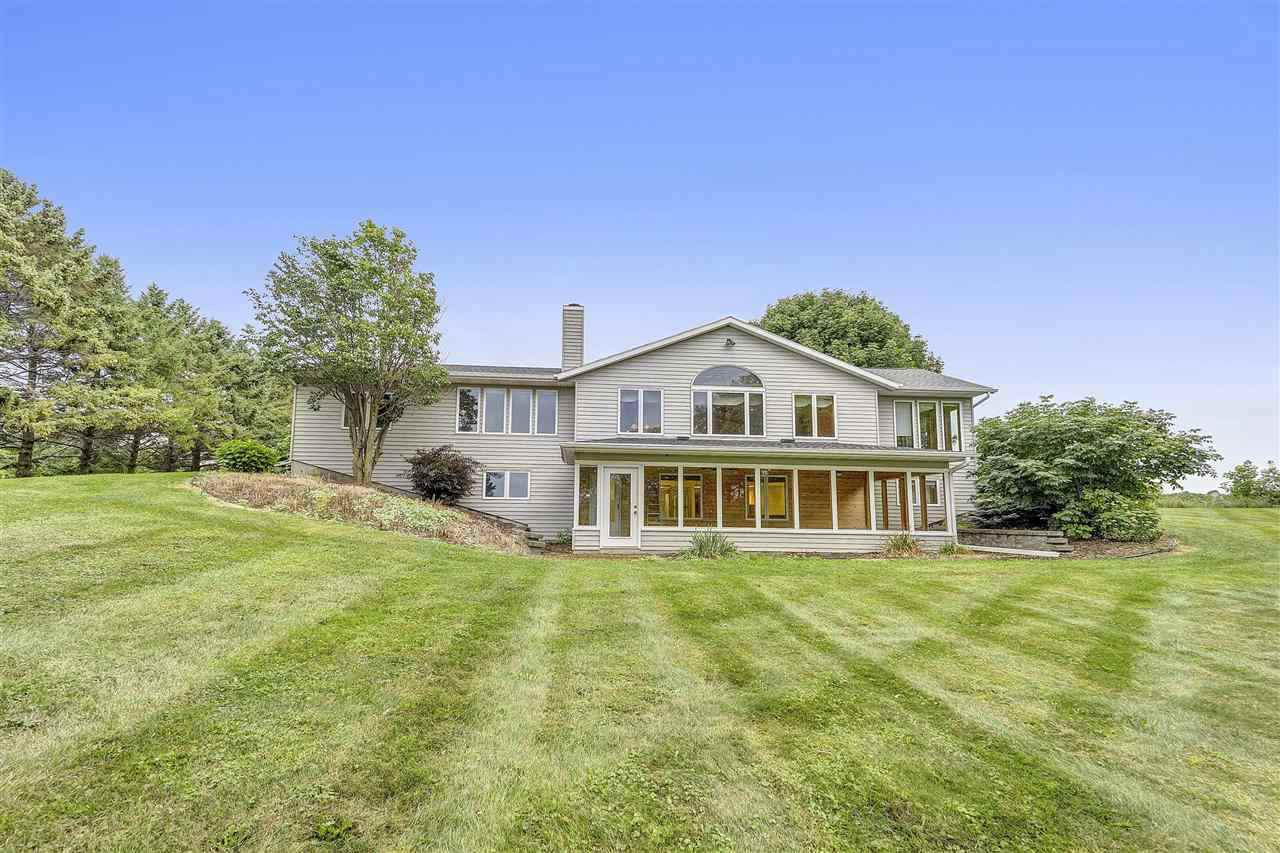 View Single-Family Home For Sale at E0837 COUNTY LINE ROAD, Luxemburg, WI