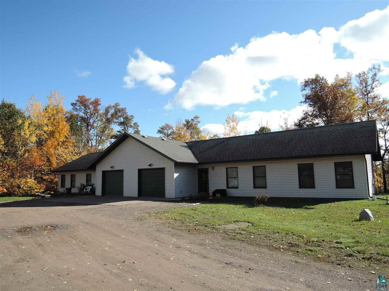 Sales Event, the List price is $260,000 w/an opening bid of $245,000!  Property may be sold any time prior to event. Offers are subject to Seller?s approval. Side by side duplex ranch on 1.26 acres all one level on dead end road. Excellent opportunity for steady cash flow with with two dependable renters paying their monthly rent and pay for their separate utilities for gas, electric, water/sewer bills. Exceptional value, the cost to build new would be approx. $250 per square foot this home is $93 per square foot. Each unit has 1+ insulated finished garage with power, two bedrooms, kitchen, dining area and large bathroom, patio doors to large deck, located on a dead end road in a nice quiet neighborhood close to Iron River!   Features open floor plan concept with a great room (living room) with gas fireplace, beautiful large kitchen with oak cabinets, dining room area with patio doors leading to a beautiful large deck with a privacy wall and nice back yard with a country feel with peace and tranquility. The master bedroom has access to the full bath with jetted tub and an extraordinary large walk-in closet. Included with this sale is (2) stoves, (2) refrigerators, (2) washers, (2) dryers, and ample closet and storage. This property is set up for another duplex building that will make an excellent additional income opportunity. See RealtyHive for additional disclosures and details, contact Sherri DeHahn License #57593-90 for any questions about this sales event (715)413-0230.