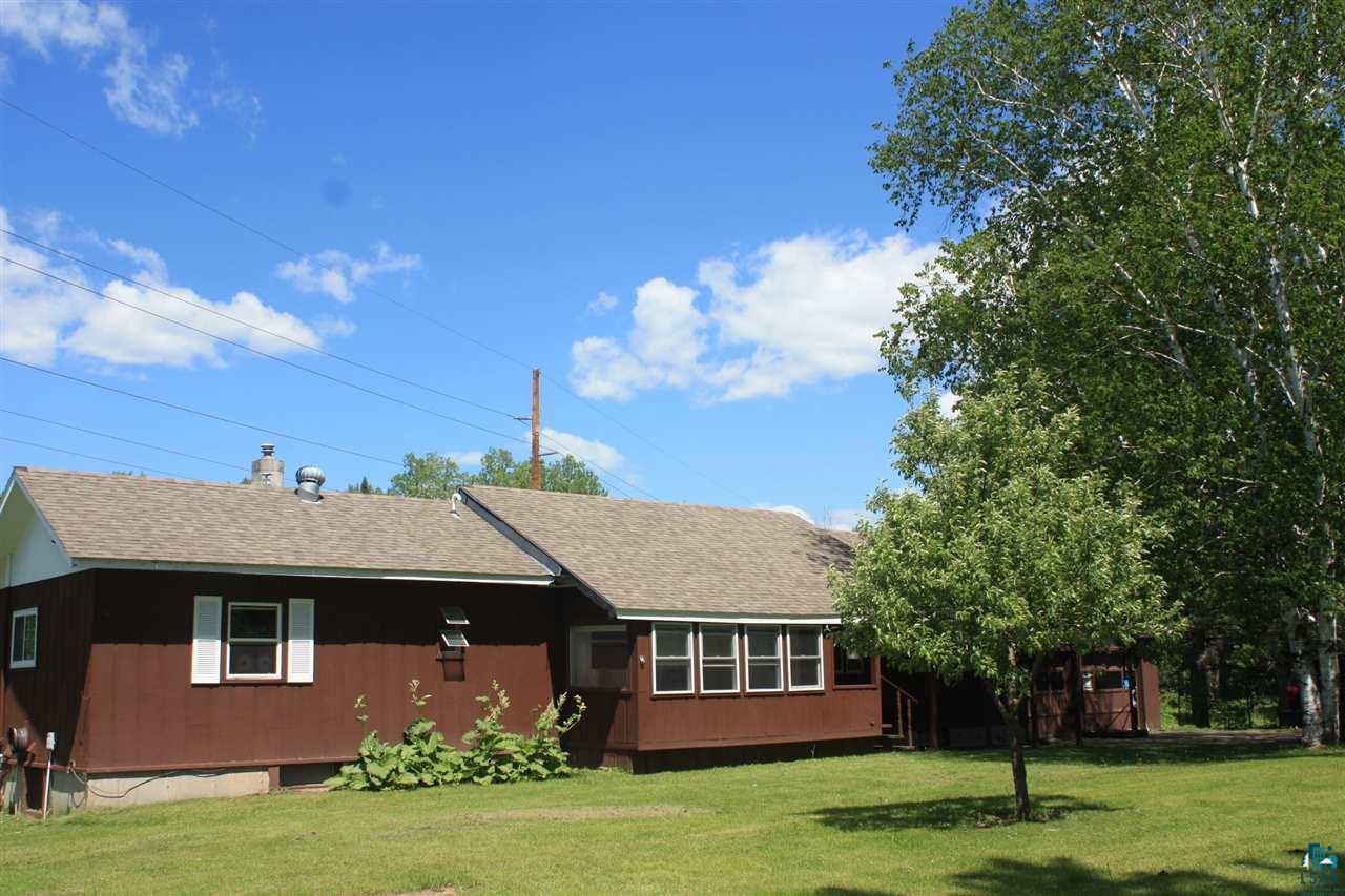HOBBY FARM! Thinking about your very own hobby farm? This may be the perfect answer w/spacious barn offering room for horses and all your other pets! This 2 bedroom, 2 bath home features a spacious layout with 3 season porch, rear mud/entry room, full basement, large bedrooms and enough space for a large family/rec room all located on 5 acres in the middle of the Brule River State Forest. Your backyard extends right into the forest full of abundant wildlife with hundreds of acres of public hunting/hiking land.  It has easy access to the Tri-County Corridor right from the property.There is a 2-car garage and a 36' x 45' pole barn with a barn room, 2 horse stalls and an additional chicken roosting room complete with nesting boxes. A perfect place for a hobby farm. There are 3 apple trees (2 are honey crisp), and 2 pear trees that produce delicious fruit. There is rhubarb and an asparagus patch and ample space for a large garden that already has rich soil and compost added to it. There is even space to grow corn! There is a 6 foot diameter rock lined fire pit and picnic table included for marshmallow roasts and stargazing next to the campfire. This property was also a working hop farm in the past and still has hops and structure in place for growing your own hops if desired. It is located close to Afterhours Ski Trail and a mile from the Brule River, so much potential for a great family home or hunting/summer getaway.