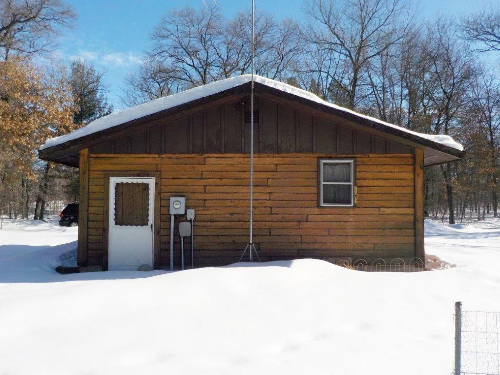 10 acres of high and dry wooded land north of Grantsburg near the St Croix River. The cabin is rustic with a bath, bedroom and a living area. Current use of cabin is 12' x 12' living quarters and 12' x 12' garage. There is a conventional septic, sandpoint well and the heat source is a wood stove. Other structure is a wood shed.