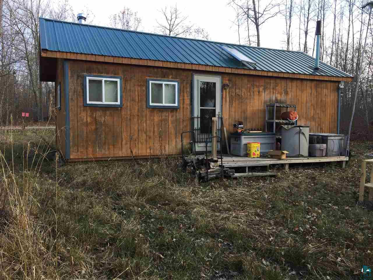 Off Grid Living - Ready for this years deer camp?  Grab this one fast!  14 x 28 Amish built building.  Solar Power, Wood Stove, On demand Hot Water, Generator ready, Stands up and ready to go.  Trails groomed and deer fattened up for you.  St Croix River Landing 2.5 miles one way and 1.5 miles the other.  Excellent fishing. Take a look today!