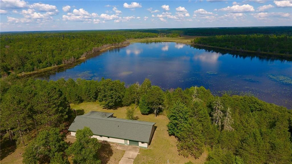 Your legacy starts now by owning your very own private 40 acre swimmable lake with 17 ft of depth, stocked with fish surrounded by  171 acres of quality forest with a mix of hardwood- pine trees and established trail system. Renovated 3 bedroom home has fresh and open floor plan with large kitchen, dining area and  family room for gatherings. Wall of windows in 3 season porch overlooking lake provides a perfect space to begin and end the day. Ultimate privacy! Includes Home Warranty!