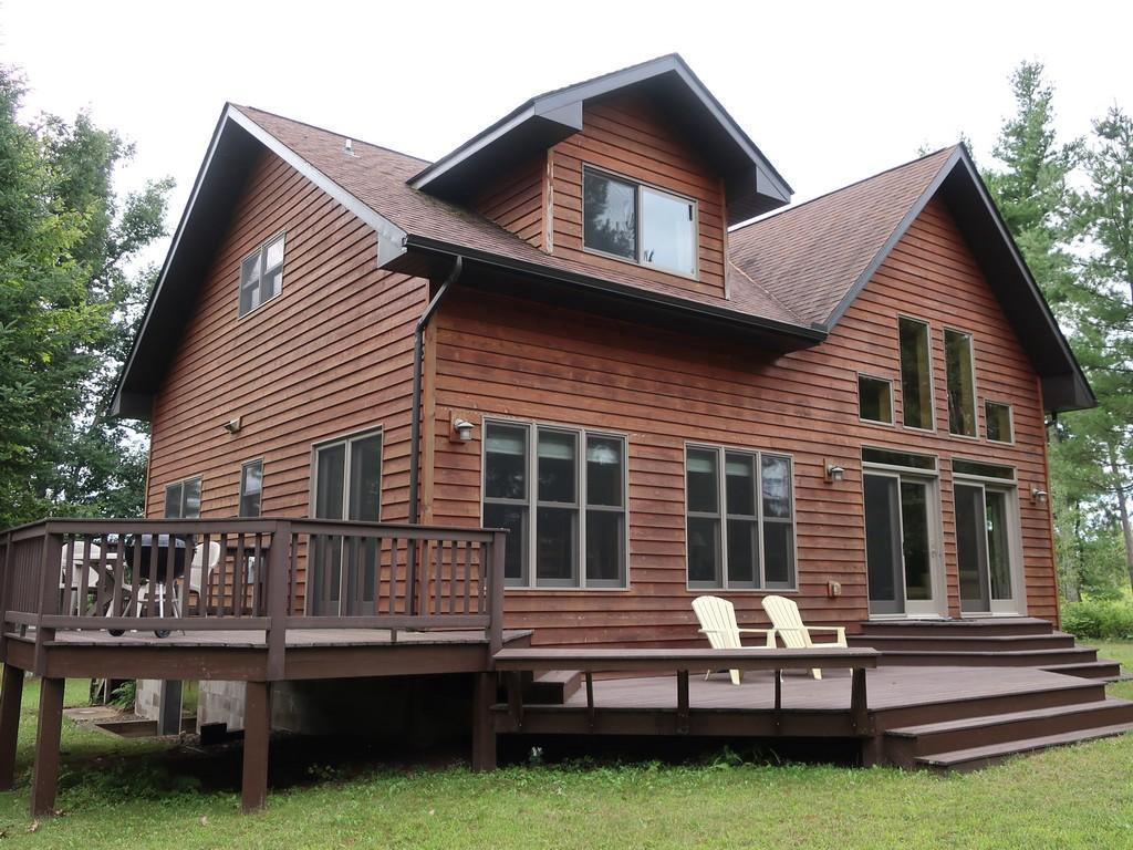 Quality cedar chalet on a beautiful west facing lot. Wood floors with a stone wood burning fireplace. Large loft with sitting area, bedroom and full bath. Lower level is ready to finish with 3 large lookout egress windows and a stubbed in bath. Solid stairs to rock and sand bottom frontage on a clear water lake. Located in the heart of lake country.