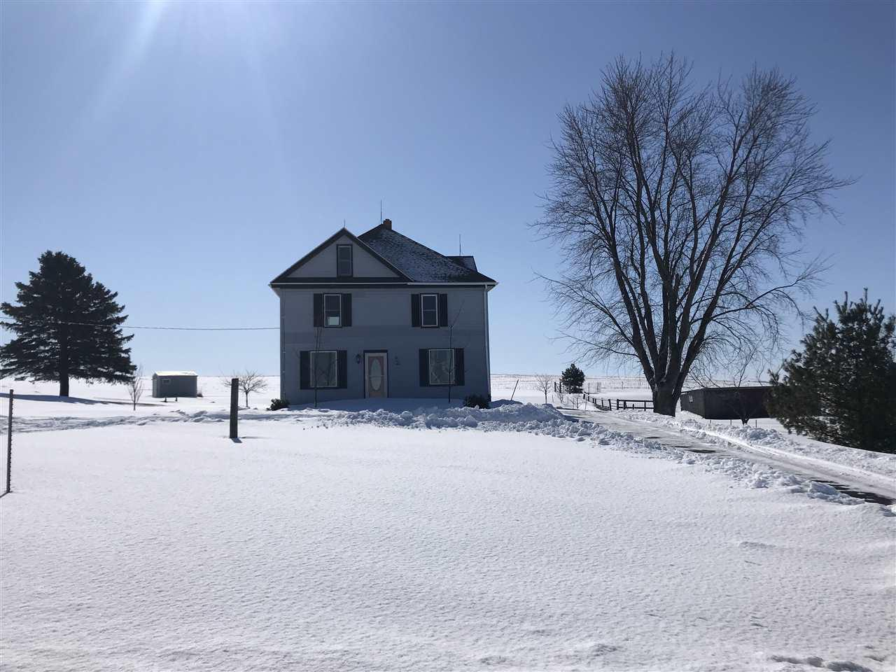 Country living! 2 acres w/panoramic views. Solid, well built 2 story home is move in ready. Very well maintained, this house needs nothing. 2 bed, 1.5 bath. More bedrooms can be added w/ a little remodeling. Full, dry basement and a walk up attic can be finished for more bedrooms, loft area or a number of possibilities. Horse stable with good fences all around. Great neighbors. Lots of room to build a garage or big shop.