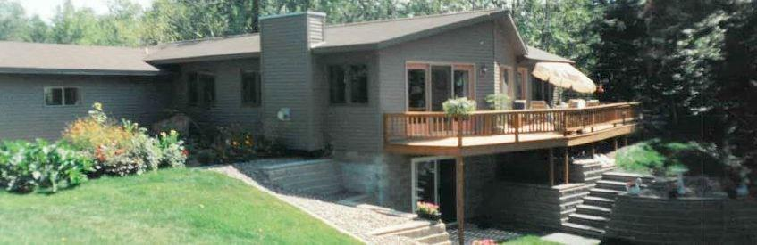 This western-facing home is on the original site of the Loch Lomond sales office, and features a breath-taking view of Red Cedar Lake.  A gentle slope to the lake frontage promises a shallow, sandy-bottom lake approach.  The house features an open concept main floor plan with many new updates. The lower level has a recreation room, bedroom, storage room, workshop, cedar closet, and bath.  The exterior of the house has maintenance-free siding.  Recreation is at your fingertips. The home is less than a mile north of the Loch Lomond Beach Club; a mile south of Tagalong Golf course.  The ATV/UTV/snowmobile trails are at the end of the driveway, and great fishing just feet away from the shoreline.  This rare opportunity to buy into the ideal waterfront location is open to you!