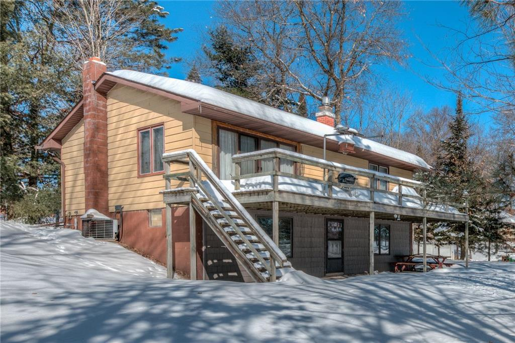 Classic year round cabin/home! HUGE 4 car garage and workshop area, gradual slope to the waters edge offering clear water and good fishing. Hop on the ATV'S and snowmobiles and go right from the driveway! Bonus room used as a 3rd sleeping area and would need egress. Baths on both levels, newer shingles and everything you need North of the stress zone! 13 month Home warranty will go with the home and additional lots across the road could be purchased for future growth, guest house. Hurry...