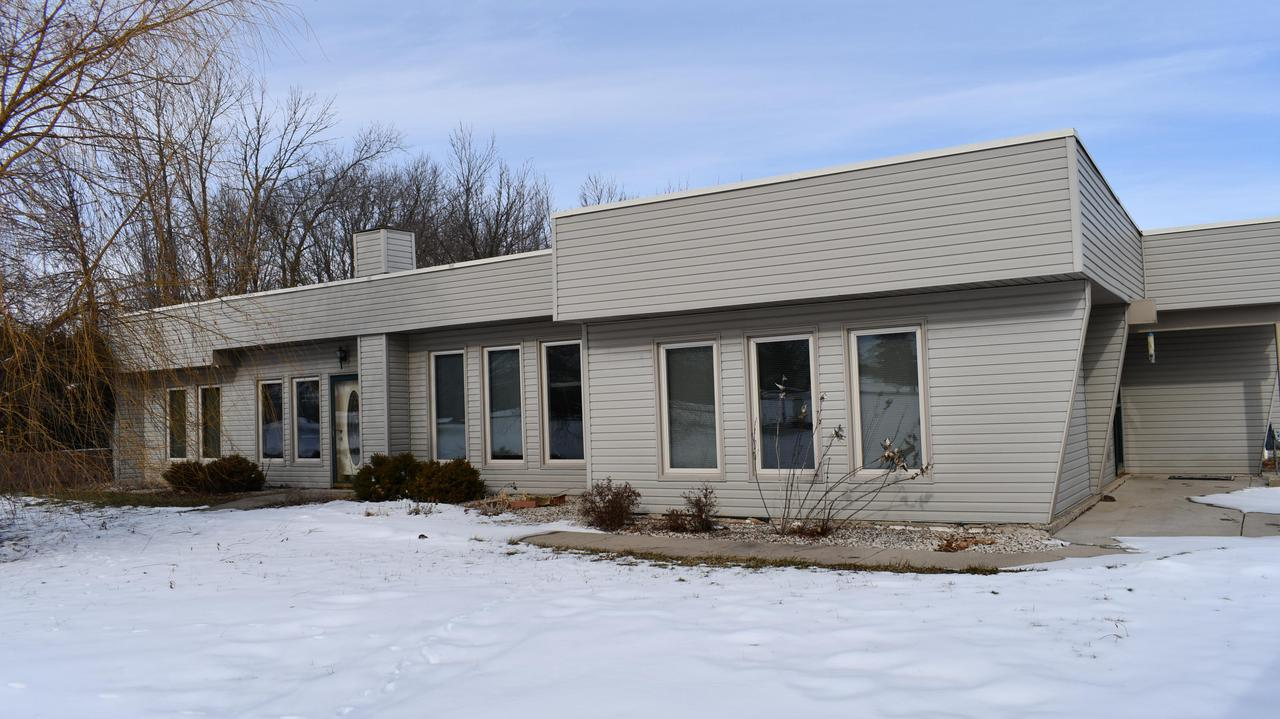 Looking for a ranch?  On 5 acres??  Look no more!  This 2,362 sq. ft. earth home is stair free and most energy efficient to boot!  Kitchen/Living Room/Dining room is ''Open'' concept with 3 bedrooms, 2 baths, a laundry/mechanical room and an extra 21' x 13' room for storage.  Currently there is not a wood-burner, but there is definitely a place for one!  All the windows are southern exposure for warmth and natural light.  The garage is 40'x24' and there is also a 20'x16' shed.  Bong Recreation, Brightondale Golf Course (45 hole) and I-94  are within minutes.  Definitely worth a look!