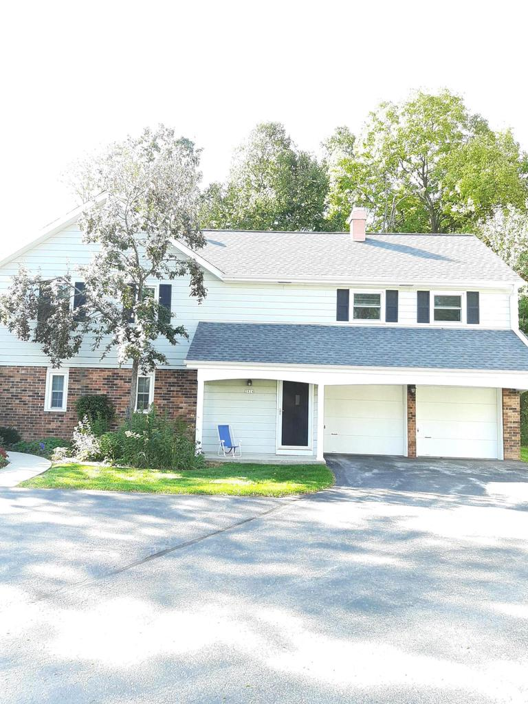 Beautiful, highly desirable location within walking distance to River Club of Mequon. Est. 2 bed, 2 bath, open concept 2ND FLOOR CONDOMINIUM. FF private entry, covered porch. Private rear patio slab w/ secluded exposure to private woods. Updated eat in kitchen, new SS appliances 2019. 2nd. fl. laundry adjacent to  kitchen, washer & dryer negotiable. Dining room w/ private balcony overlooking park like setting/private woods. Large LR w/ cathedral ceilings & 2-sided NFP. Master bedroom suite w/ updated bath. W/I full height glass & natural stone shower. HWF in kitchen & 2nd bath. New carpet 2018. Furnace, AC, roof & widows replaced last 10 years. Updated HWH & 200 amp electrical. Large 2.5 stall garage w/new paint, openers incl. Private basement storage.