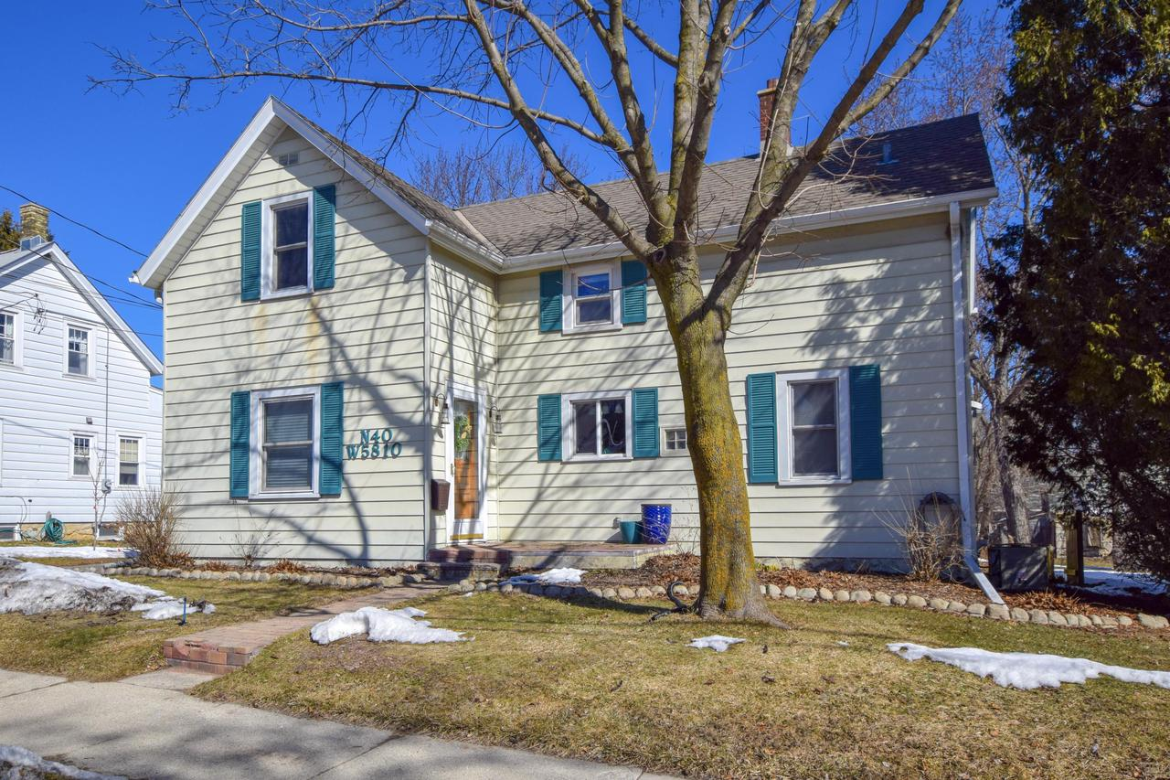 Full of charm and character, this classic 1880 Cedarburg home has plenty of updates, comfortable spaces, and is only a couple blocks from historic downtown! 2 beds/2 full baths, updated kitchen, beautiful original hardwood flooring throughout, and attached 2.5 car garage with access to the large basement. First floor features spacious LR/DR combination, updated white kitchen w/ granite and newer SS appliances, full bath, and huge, convenient mudroom off garage. Second floor features master bed w/ attached bonus room (nursery, office, etc.), 2nd bedroom, and generous full bath boasting exposed brick and freestanding tub. Fantastic deck overlooking the roomy backyard. Tons of storage in the basement and throughout the house. Just in time for spring...don't wait on this great home!