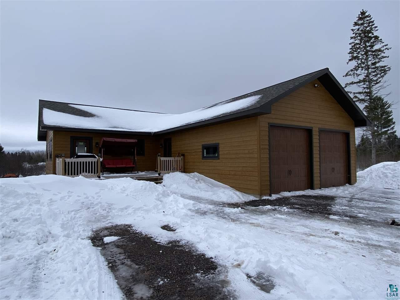 Newer 4 bedroom, 3 bath home (built in 2015).  2288 Square feet of all usable space.  Upper level starts with an open living/kitchen/dining area and has 2 bedrooms, 1 being a master with bath that has walk in shower and large walk in closet.  Also there is a convenient main floor laundry area.  Lower level has egress windows and is above grade for a full walk out to the back yard from the family room.  On this level there are 2 bedrooms, one currently being used as an office, and another full bath.  The land features 40 wooded acres in the front and opens up to 40, more open acres in the back, with some beautiful views and great hunting or hiking.  Trails have been mowed throughout the property and a foot/ATV bridge over the creek makes it all very accessible. ATV and snowmobile trail access for year round recreational enjoyment.  Work from Home?  This home has Fiber Optic Internet!  It does not get any better than this!