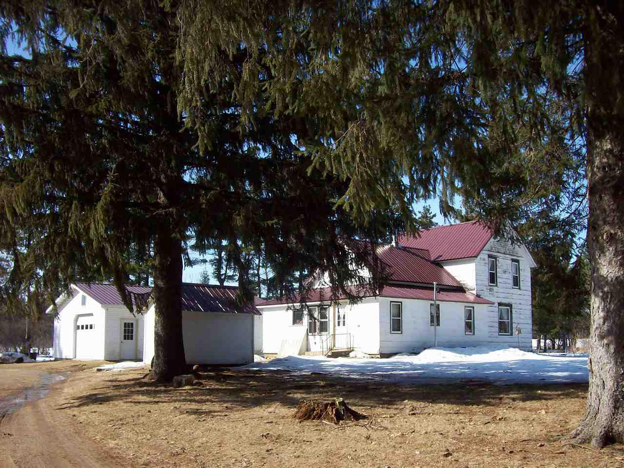 Country living! you have it all here, 16 acre farmstead large 4-5 bedroom farm house, 46 x 36 2 story barn, 36 x 24 2 car detached garage, mostly wooded with great deer hunting. Home is currently set up for an Amish family, no elec. power, everything runs on LP gas, LP Frig, LP Stove, LP lights, wood stove burns wood, Well pump is run on air pressure, good well and septic. Great place for horses or any live stock, chickens, small animals, large animals, exotic animals, pets, dogs, cats whatever you like. Circle around driveway for easy in and out. The home has a metal roof, metal siding,  16 x 14 wood shed. private setting and close to I 39 for easy commute to Stevens Point, Madison, Wis Dells, Wautoma Portage and more. Get off the grid plant a garden raise your own food. Close to DNR land