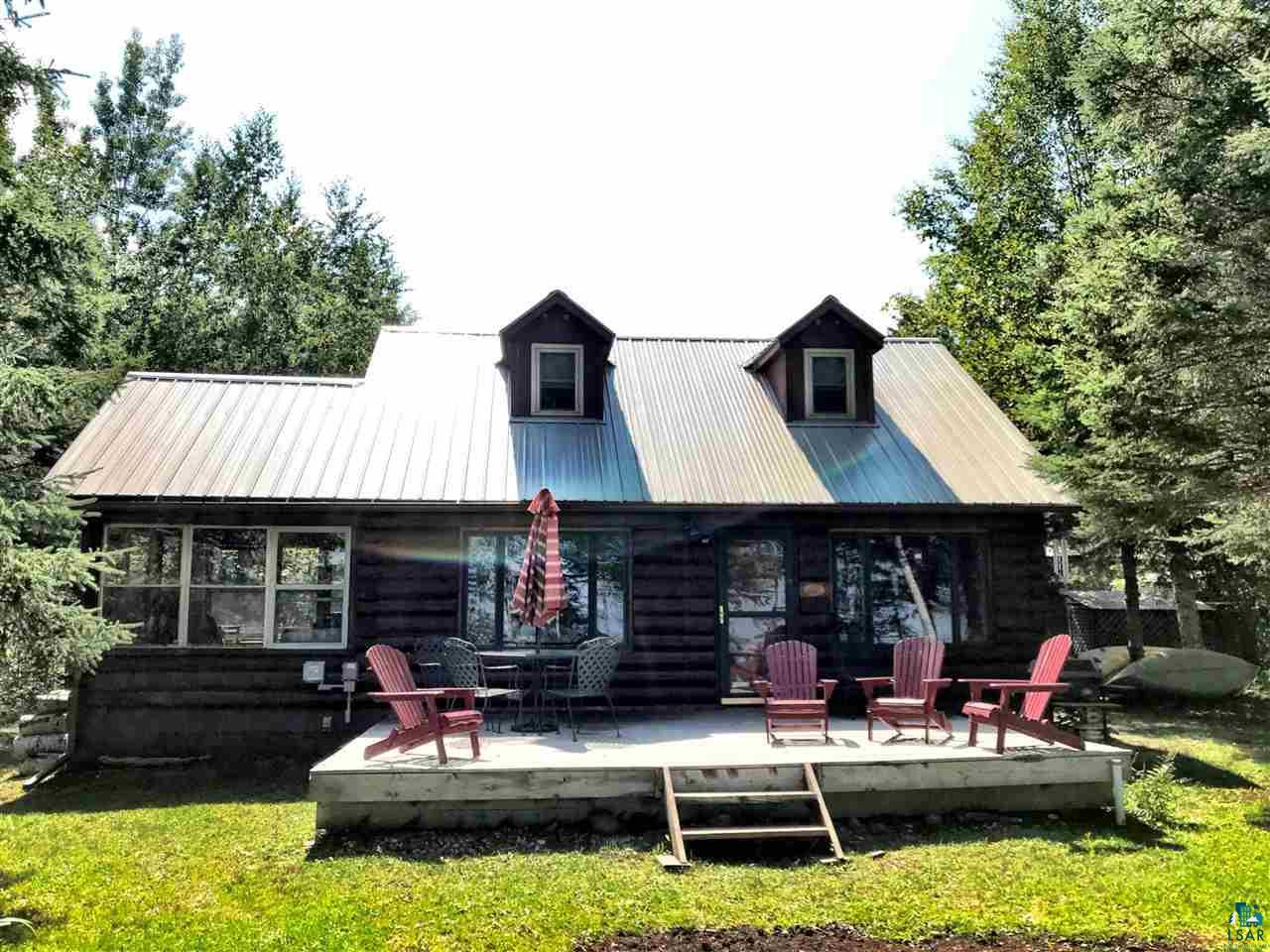 """Log cabin on five acres with 300+/- Lake Superior SAND BEACH!! This opportunity is just that...an """"opportunity"""" with gross yearly rental history near $25k. Being sold """"turnkey"""".Great for swimming, body surfing or wading with a pole in hand. Cabin is quaint and comfortable. On demand hot water heater,water softening unit-both high end. New large wood burning stove and new washer/dryer. Private & peaceful location at the end of dead end road. Located near Bayfield/Douglas County line making Duluth about 30 minutes away and the South Shore villages along Lake Superior including Cornucopia even less. Come look at this one today, as I don't expect it will last long!"""