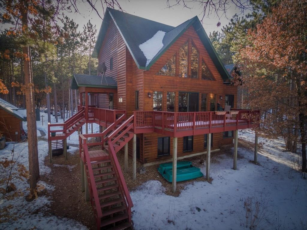 This stunning chalet offers it all.  Custom build, energy efficient, with 4 bedrooms, 3 baths, chefs kitchen, solid maple hardwood floors with cedar vaulted ceilings and multiple entertaining spaces.  Relax on one of the large decks taking in the views of the lake or in the large screen porch among the towering pines.  Quality recreational lake offers sand bottom, excellent fishing, boating, or kayak to the St. Croix River. County land, Crex Meadows, Gov Knowles State Park, ATV and snowmobile trails out your back door for the outdoor enthusiasts and hunters.  At the end of the day take a soak in the hot tub.  Large detached garage with loft to store all of the toys, and all within 14 miles of Webster.