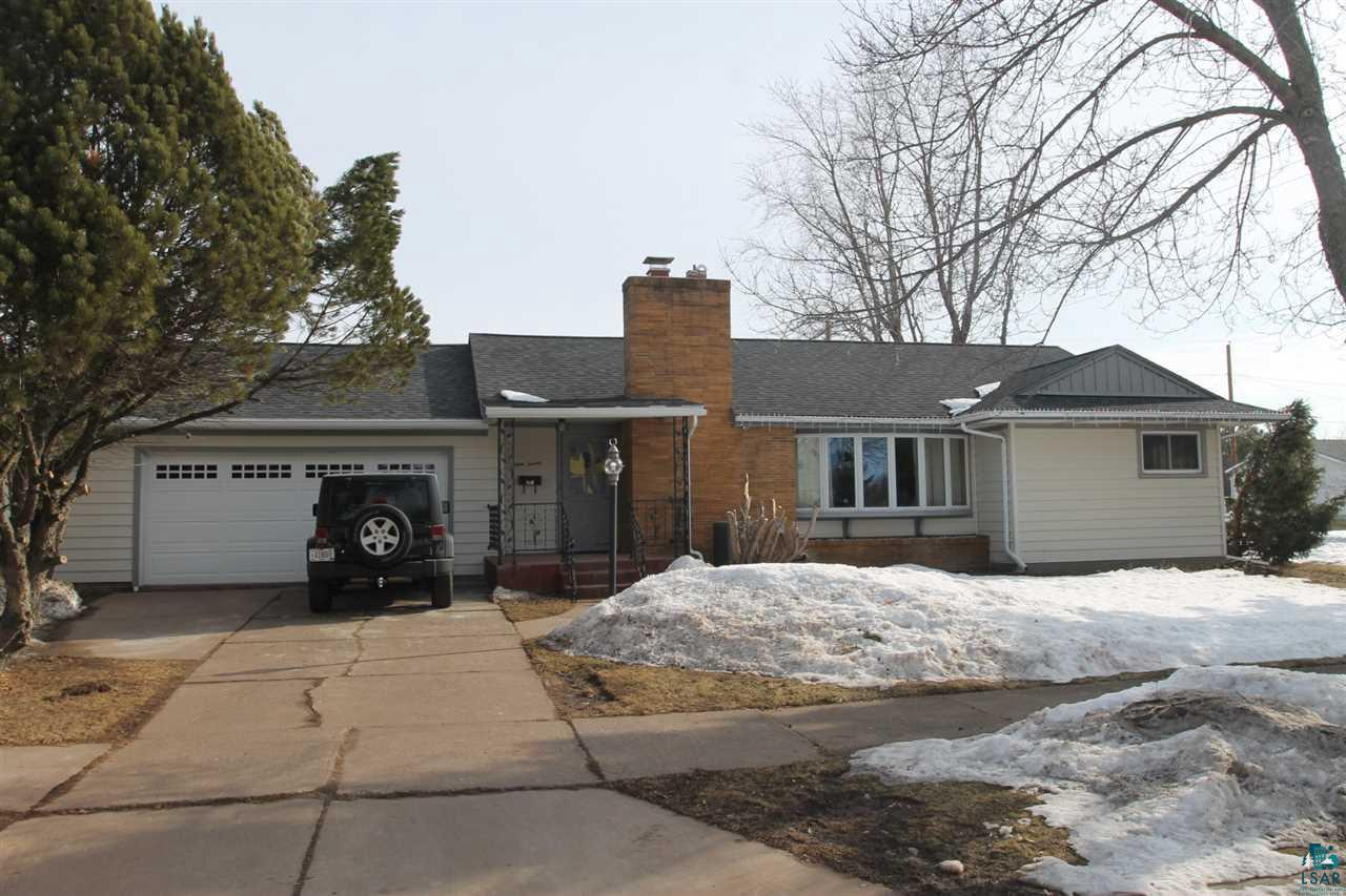 3 bedroom, 1 bath ranch with a wood fireplace, 3 season room that overlooks the fenced in backyard.  2 car attached garage with detached storage/shop building.  Full basement.  Close to schools.