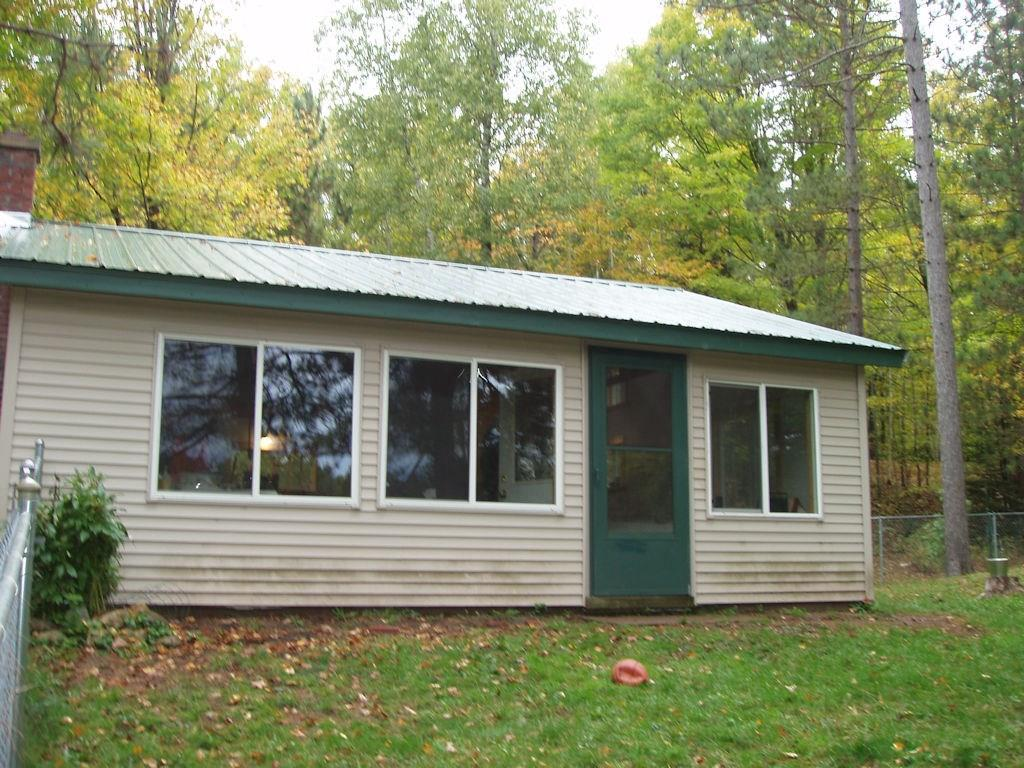 (261/DW) Great water views can be enjoyed from this 24'x24' cabin that has been completely renovated. The cabin was originally built in 1952 but the owners have completely renovated the building down to the studs. Metal roof. Exterior has vinyl siding, all new vinyl windows. Walls and ceilings have been well insulated. Dry core flooring, vinyl flooring. Metal exterior doors. Cabin is wired for a generator which is included. Gas refrigerator and stove. LP gas space heater. There is a small storage shed, outhouse and an additional 12'x12' two story bunkhouse currently used as workshop/storage. Nicely wooded property with end of the road seclusion. Must see to appreciate this truly unique property. Priced to sell at $77,900. See it today. 2019 taxes: $930. (27-40N-1E)