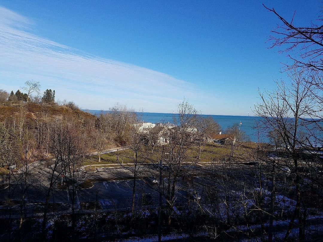2BR/1BA home situated on a bluff overlooking Veteran's Memorial Park & Lake Michigan. Incredible location just a short walk to vibrant downtown Port Washington shopping & restaurants, Interurban Bike Path and Marina. Exposed lower level walk-out to large deck with lake views. Rent, Rennovate or Start fresh and build your dream home! The possibilities are endless. Great rental history. Sold as-is. Come see it today!