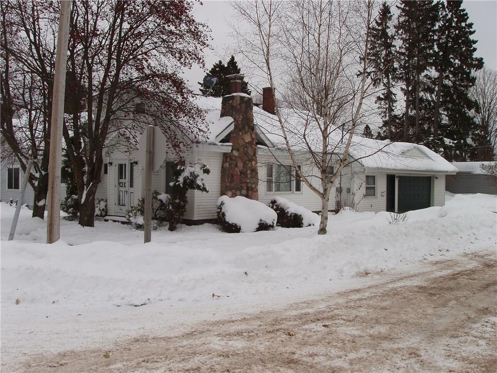 (375/PB) Priced Right! This 3 bedroom, 1 1/2 bath home on the corner of 8th Ave. and 6th St. in Park Falls is a great value at this price. This offering features a living room with fieldstone fireplace, galley-type kitchen, dining area with built-in China cabinet, main floor bedroom and full bath. The upper level has two spacious bedrooms and a 1/2 bath. Lots of built-in storage. Full basement, attached oversize 2-car insulated garage. 50x120+/- foot corner lot. Pleasant residential neighborhood. Make an appointment today. Asking $69,900. 2019 taxes: $1,692. (23-40N-01W)