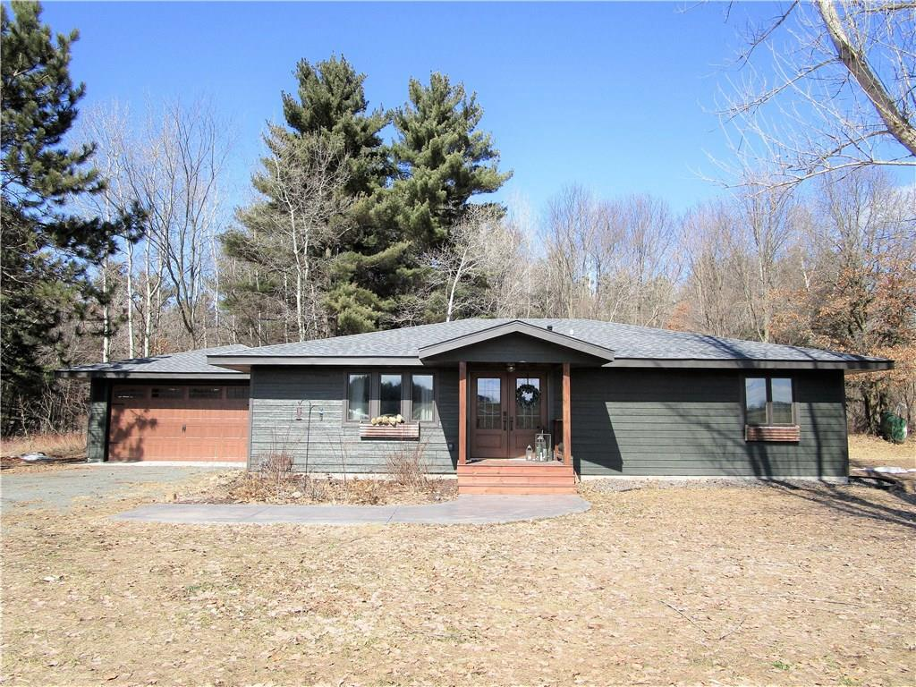 Beautiful, custom-remodeled 2BR/2BA home on 4.98 wooded acres. Open floor plan with vaulted ceiling & huge wood beams, kitchen featuring custom cabinets & custom table/island with pendent lighting. Master bedroom has with large walk-in closet & private master bathroom with soaking whirlpool tub, walk-in shower & double sink vanity. EVERYTHING has been redone and is new-roof, siding, furnace, AC unit, flooring, etc. Attached garage plus 24x24 insulated shop. HGTV- worthy home in a great location!