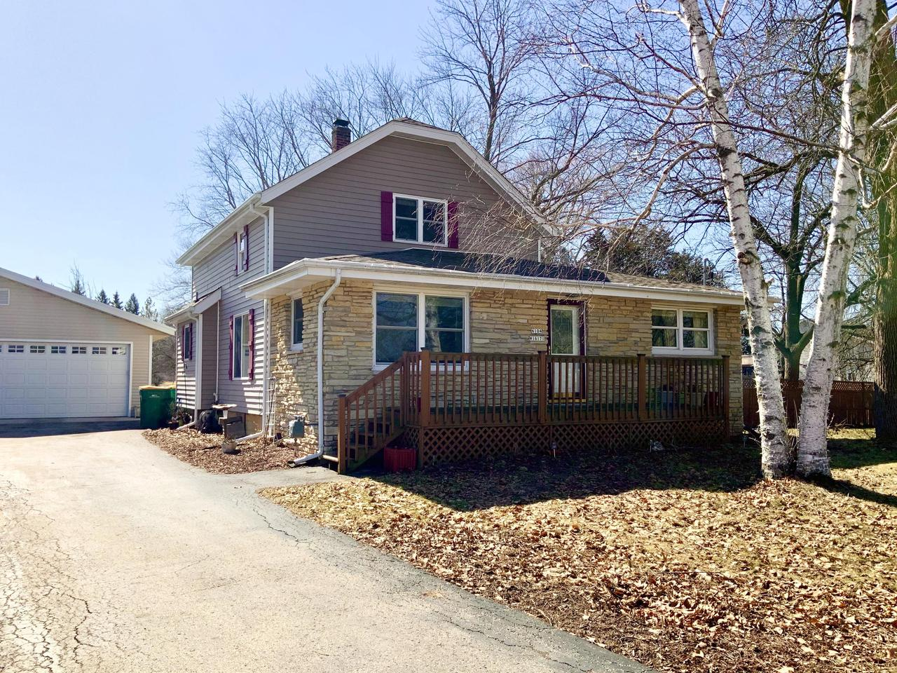 AMAZING OPPORTUNITY to subdivide this beautiful 5 acre property into a max. of 5 separate sellable lots (per seller). GREAT INVESTMENT!! Survey available. Seller has received preliminary approval from Village of Germantown to subdivide. Live in well-maintained, charming updated farmhouse w/9 car garage & subdivide the remainder of lots to sell (per seller). Road access & water & sewer avail. at South end of property. 9 car garage (30'x70') w/metal roof & 9ft ceilings plus 4 garage door access points, equipped with car lift & 100 amp service. Property features 200 amp electrical panel, updated kitchen, newer windows & flooring, abundance of storage throughout, composite deck (21'x15') fruit trees on property, water irrigation system w/private well, walking trails, fire pit & great location!