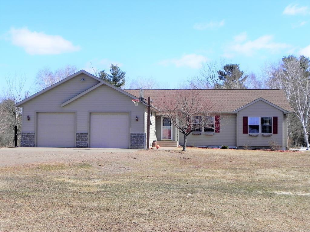 Beautiful 5BR/3BA home on 10 acres SE of Grantsburg. Open floor plan with vaulted ceiling, large kitchen with center island, main floor master bedroom with walk-in closet & master bathroom with double sinks, whirlpool tub & separate shower, main floor laundry & full basement with family room, 2 bedrooms with egress windows & office area. 2-car attached garage & huge 56x90 pole shed for extra parking & storage. Wooded parcel offers excellent hunting. Located close to many area lakes to enjoy!
