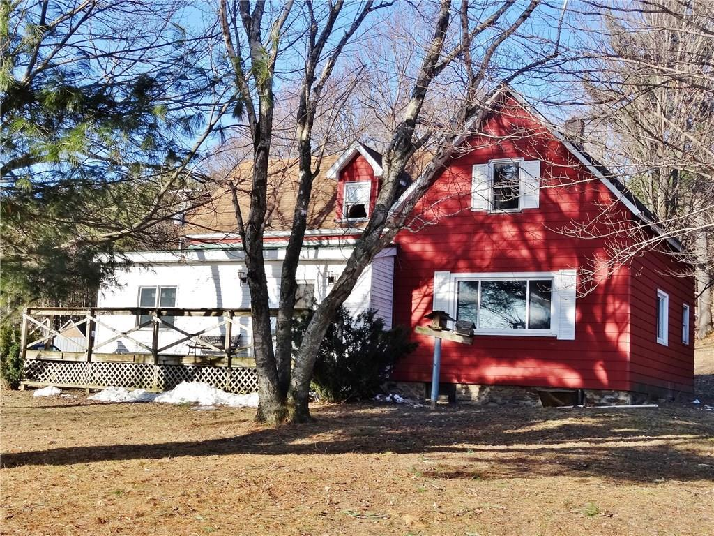 4 bedroom home on 5.04 acres is the perfect hobby farm set-up!  Includes 3 stall horse barn with electric and fencing in place.  Chicken coop, pen for pigs, multiple vegetable gardens & canning shed.  1 car garage, workshop and a smokehouse.  Apple, plum, pear and cherry trees as well as blueberry and raspberry bushes; asparagus and rhubarb beds.  Outdoor wood stove heats the home and the water year around, (year supply of wood included), electric near 2nd driveway to plug semi into.  Land is approved for 10 animal units per zoning; horse barn is 14x32 and the addition for horse stalls is 15x24.