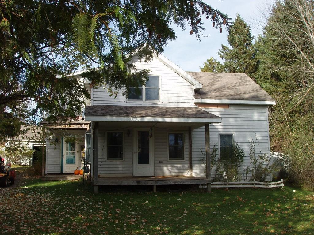 (364/DW) Real Family Pleaser! This six bedroom, two bath home is located in the City of Park Falls right on the outskirts of the city limits on County Hwy. E and within walking distance of a park and the Tuscobia Trail. The main level of the home features an entrance with washer/dryer and separate office, kitchen, dining room with patio door to deck, living room, full bath and one bedroom. The upper level features an open area/playroom, four bedrooms and full bath. Detached one plus car garage. Roomy back yard with privacy fence and above ground 24 ft. pool. Take a look at this spacious home! Asking $79,900. 2019 taxes: $1,556. (23-40N-01W)