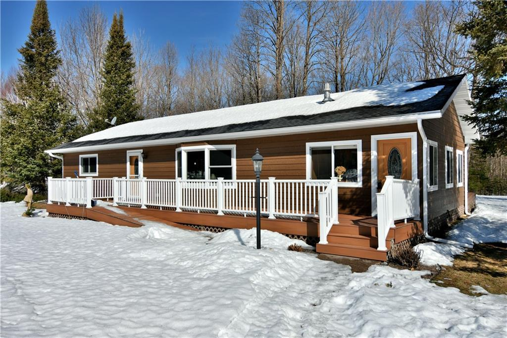 Seller is not accepting showings at this time. Wonderfully updated, no maintenance country home set on 5 acres! This home has plenty of space with an open feeling! There is a fieldstone gas fireplace in the living room and a 3-season porch that could be easily converted to a family room with just adding a heat source. The lower level offers a nice family room with exit to the outside plus two non-conforming bedrooms, and a full bath with jet tub. Plenty of closets and storage space. Additionally there is an oversizedtwo car detached garage with a workshop and more storage space. Zoned agriculture, horses or a hobby farm would work here!