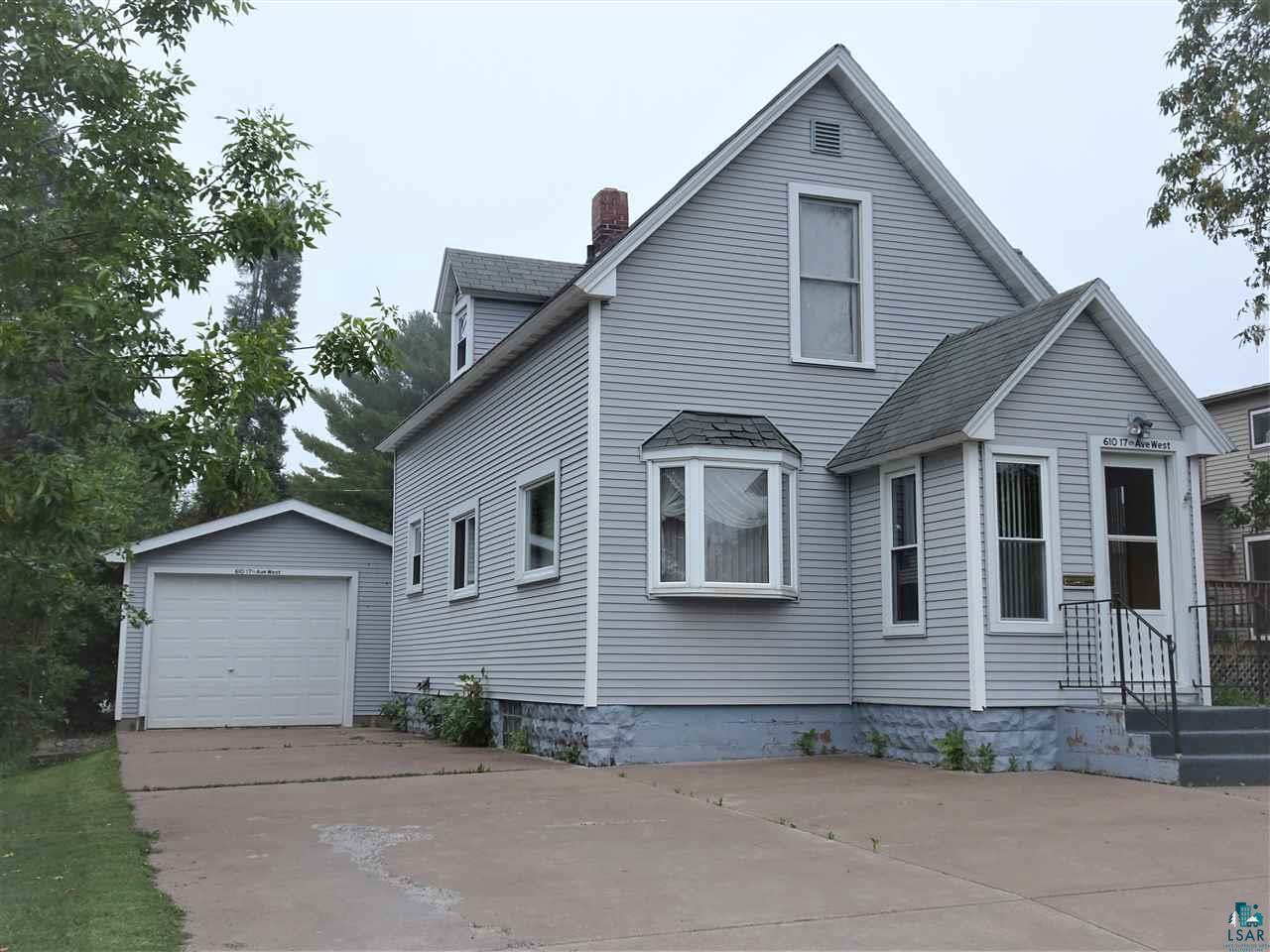 This beautifully maintained home is in the heart of Ashland.  Just a block away from the walking trail which leads to beautiful Lake Superior.  Minutes away from a convenient neighborhood store. Close to hospital and schools.  The house has a great deal of space for a large family with plenty of yard space out back.  It is a few blocks away from ball diamonds and city playground. It has a small first floor bedroom with a 3/4 bath in it.  This space could be used for a bedroom for those that may not want to tackle stairs any more.  This space could be converted into a laundry room/bathroom, and the new owners will still have three spacious bedrooms on the second floor. There is a spacious hallway and hardwood floors on the second story.  Newer siding and windows make