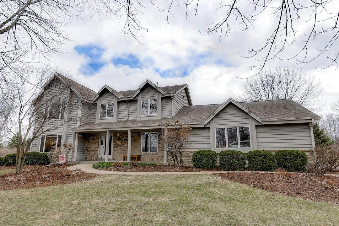 Welcome home to your lovingly well-maintained 3 bedroom, 2 full, 2 half bath colonial on 1.53 acres of land. You will love your kitchen that boasts granite counters and a peninsula, stainless steel appliances and an extraordinary eat-in dining area with a wall of windows and sliding door to your backyard patio. Your main floor includes real hardwood floors, a natural fireplace, main floor laundry, and a half bath. Get lost in your over-sized master bedroom with full walk-in closet and two separate vanities in your master bath. Entertain in the basement rec room complete with wet bar, gas fireplace, half bath and plenty of room to enjoy. Your 3.5 car heated attached garage is the icing on the cake!