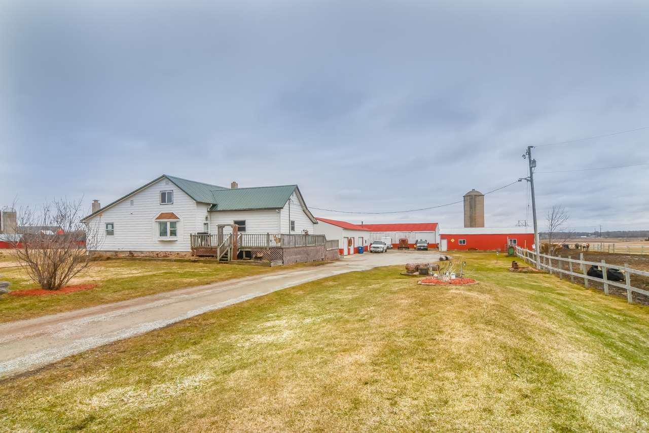 Country living at it's best with a  charming house, acreage, outbuildings and in the Pulaski school district!  10.18 acres per assessor.  Outbuildings include a barn (30x50), 2 pole buildings (30x70 and 40x75 - about 10 years old), and a huge garage (30x62) - dimensions per assessor.  Heat is a hot water boiler with a free standing wood stove.  Too many updates to list.  This home is perfect for country living, a hobby farmer or horses!  Schedule your showing today! Showings to start Thursday afternoon 4/2.