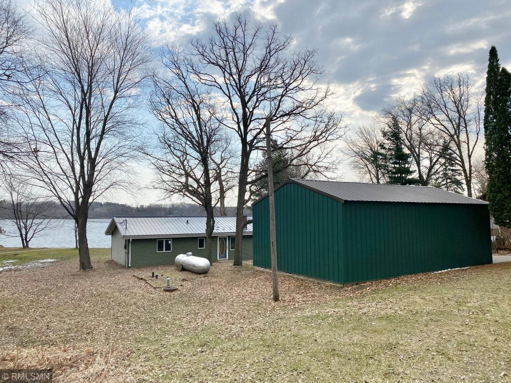 One level living- 3 bedrooms-Open/Sprawling home on Cedar Lake. New roof, new siding, black top drive. Pole shed garage 36 x 24 w/heated & insulated (15 x 24) room off back. Sliding door too! Concrete front patio & sunroom. Great level lot!