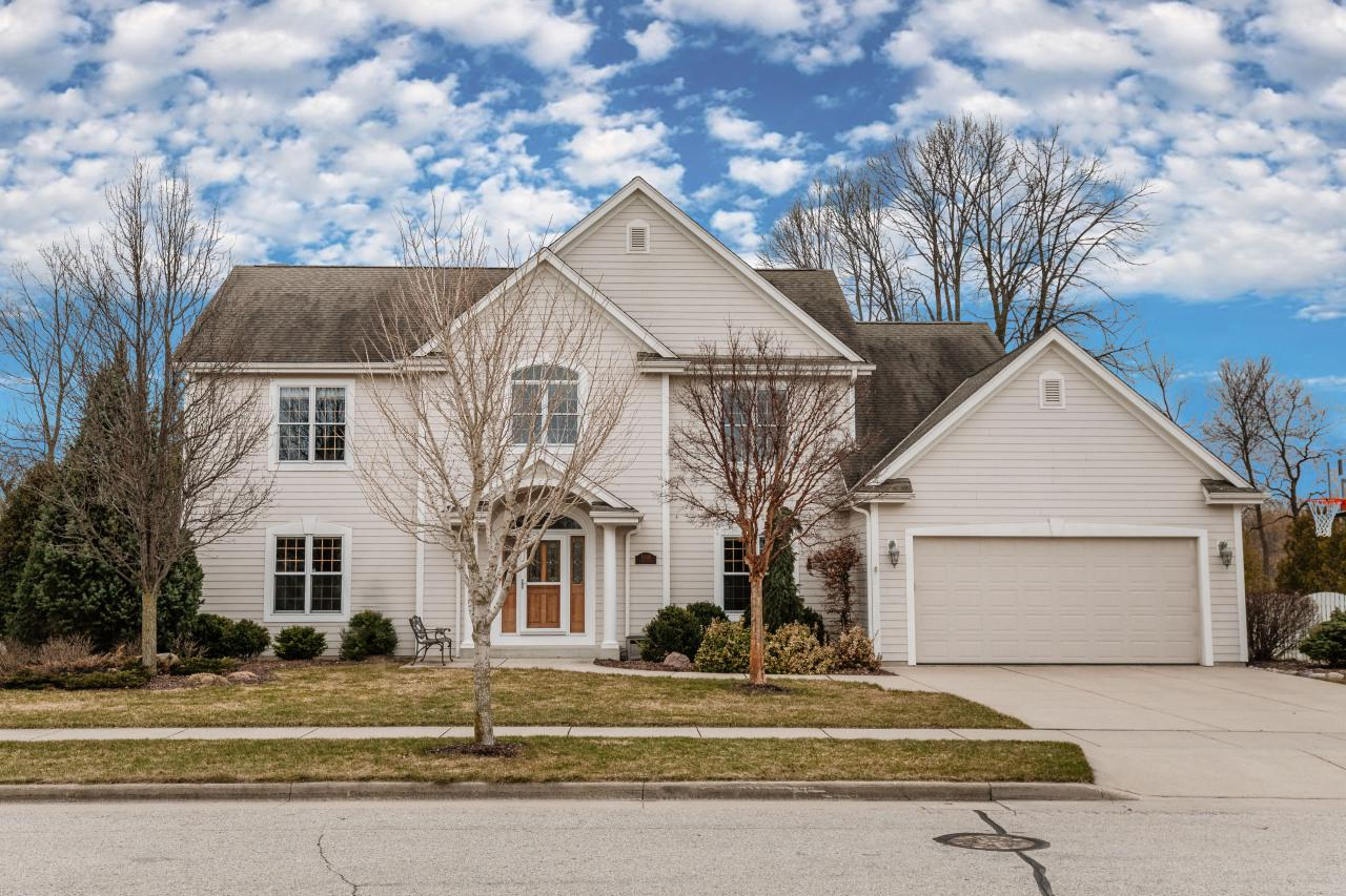 https://player.vimeo.com/video/402533790. This impeccable custom-built Freeman home is offered for the first time. Natural light gleams through the home with the southern exposure. The prairie views from the blue stone patio or three season room are exceptional. As the sellers expressed, ''It's so hard to pick a favorite part of this house. The large windows that face the backyard and adjoining field are amazing to see when you enter the kitchen in the morning. It is a wonderful house in which to create memories''.  Plenty of extra space, including a 1st floor office, 2nd floor study, and extra walk-in storage over GA. The LL is an excellent place to be for your game nights and gatherings. Many custom features are included in this home that most new construction does not offer.