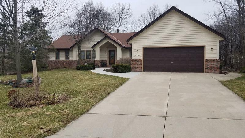 Beautiful, well built, split ranch. Open concept, gas FP, loads of windows for natural light. Eat-in kitchen, formal DR, Den,Large master suite with WIC and master bath.  2 large bedrooms and main bath.Lower level  has partial exposure, workroom, and plenty of shelves and space for storage.Backyard is private and is beautiful in spring and summer. Large covered patio for quiet summer entertaining. Subdivision has a community pool for summer outings.  Nice, established neighborhood close to shopping in both Meno Falls and Brookfield.