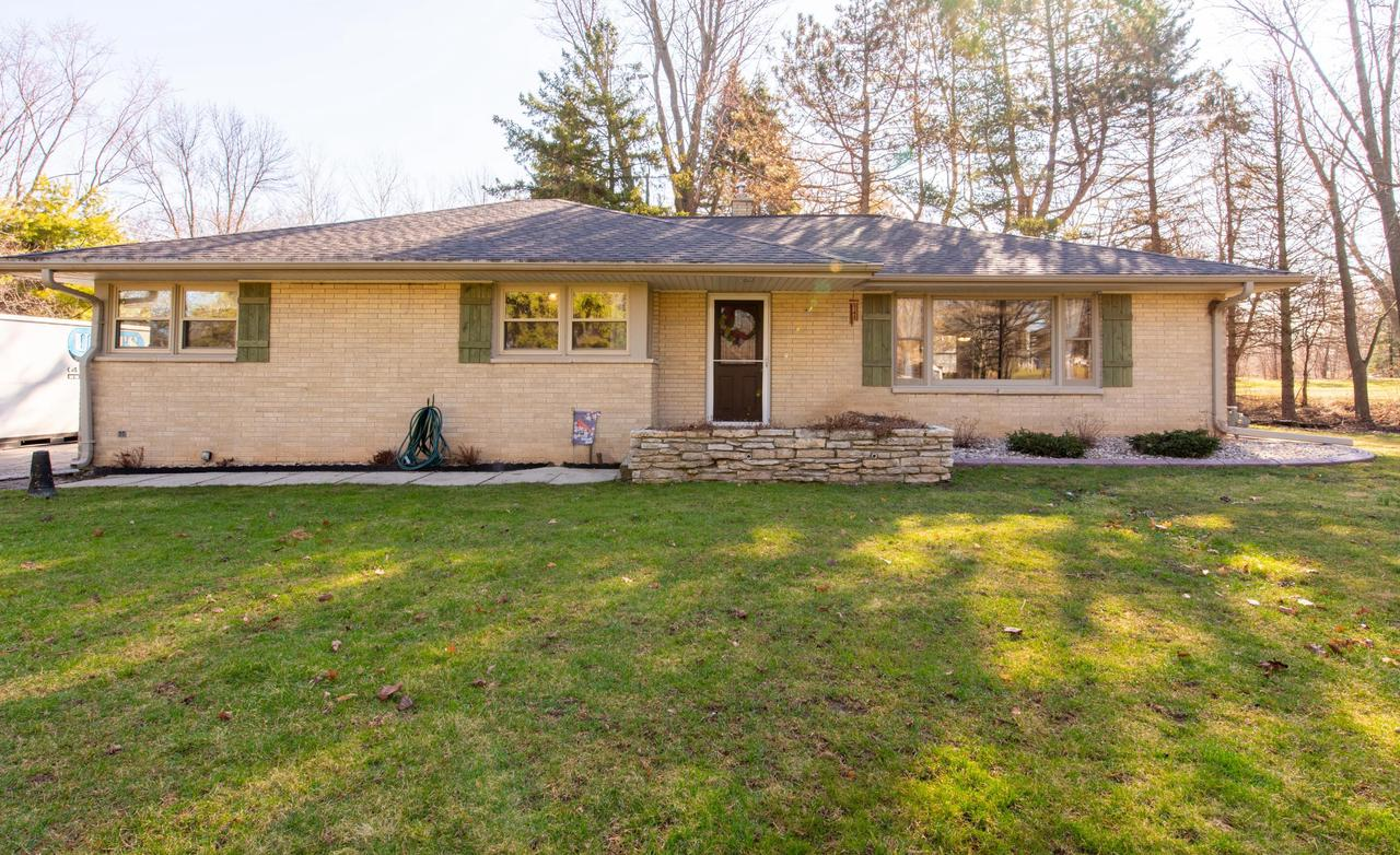 Your search is over! This well maintained brick ranch is located on a 1 acre lot in a quiet location.  The home features a large and bright Family room, updated flooring,  a Sun room,  and many other updates and features.