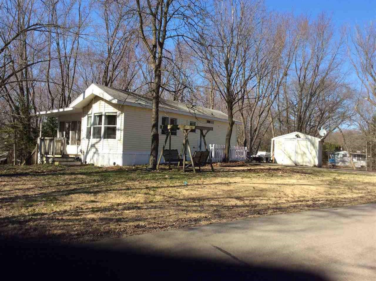 Hello Vacation! This cute 2 bedroom unit (with new carpet throughout) has the option to sleep more in the spacious, multi functioning 3 seasons room. Enjoy the fresh air from either of the covered porches. The patio is perfect to enjoy a fire on nice summer nights. This is unit is located within Rock River Leisure Estates on a beautiful lot, in a great location. You can enjoy all the amenities the park has to offer while riding on the GAS GOLF CART which is INCLUDED. Two pools, fishing pond, tennis courts, playground, Volleyball, horse shoes and more... Come check out this beautiful unit today so you can be in it by spring!