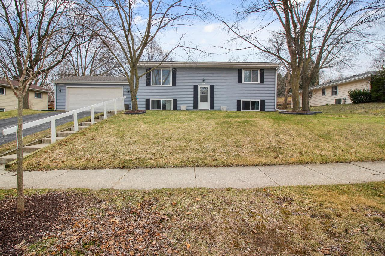 Wonderful home in favored Waukesha neighborhood.  Step up to a bright open living space with vaulted ceiling, all white trim & hardwood floors. Kitchen with glass tiled backsplash, stainless steel appliances and pantry. Spacious dinette area with sliding glass doors walk out to a 2 tiered deck overlooking the large backyard with privacy fence. Raised panel doors throughout. Full bath has tiled tub & shower combo and solid surface sinktop. 2 bedrooms complete this main floor.  Step down to a  large family room with recessed lighting, custom wet bar and wall mounted TV's for the sports enthusiast!! 2 additional bedrooms, a 2nd full bath, and laundry/utility room complete the lower level. Storage shed. Convenient to shopping center, theater, restaurants, freeway access. 1yr Home warranty!