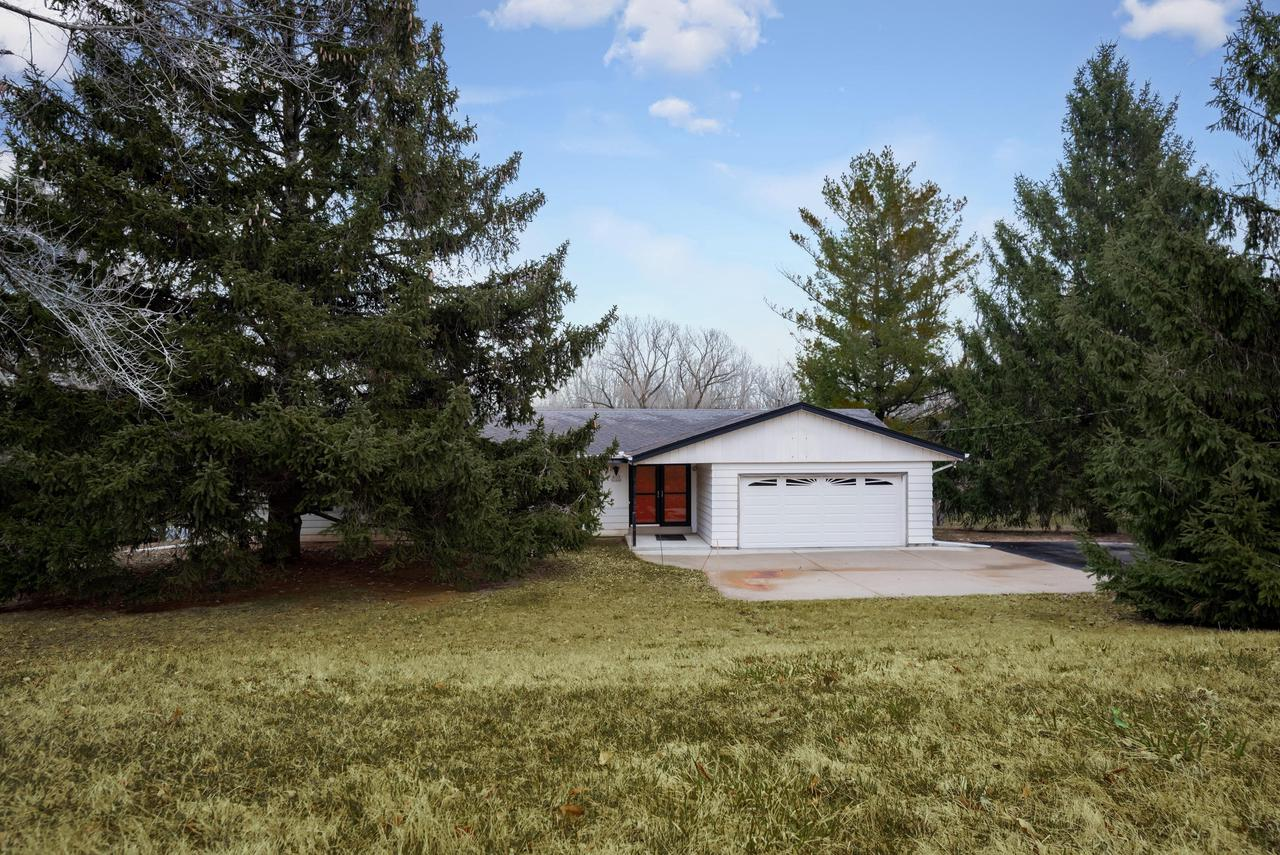 Classic 3b/1.5 bath ranch on a serene acre has 150 ft of Menomonee River Pkwy frontage! Walk out LL to a deep, sloped lot that does NOT require flood insurance. This home is completely freshened up & move in ready, keeping the best of the original build & updating the rest.  Appreciate a price that makes adding personal touches & owning in this prized location possible!  Gleaming redone oak floors, newer windows, new appliances & countertops, new main bath & fresh neutral decor. Flexible open plan has family room that could become a master suite.   A truly convenient location near freeway, shopping, hospital, schools!  Room to add more equity by improving here! Such beauty living on the water where a parade of wildlife is common. Conservancy across the river preserves the views.