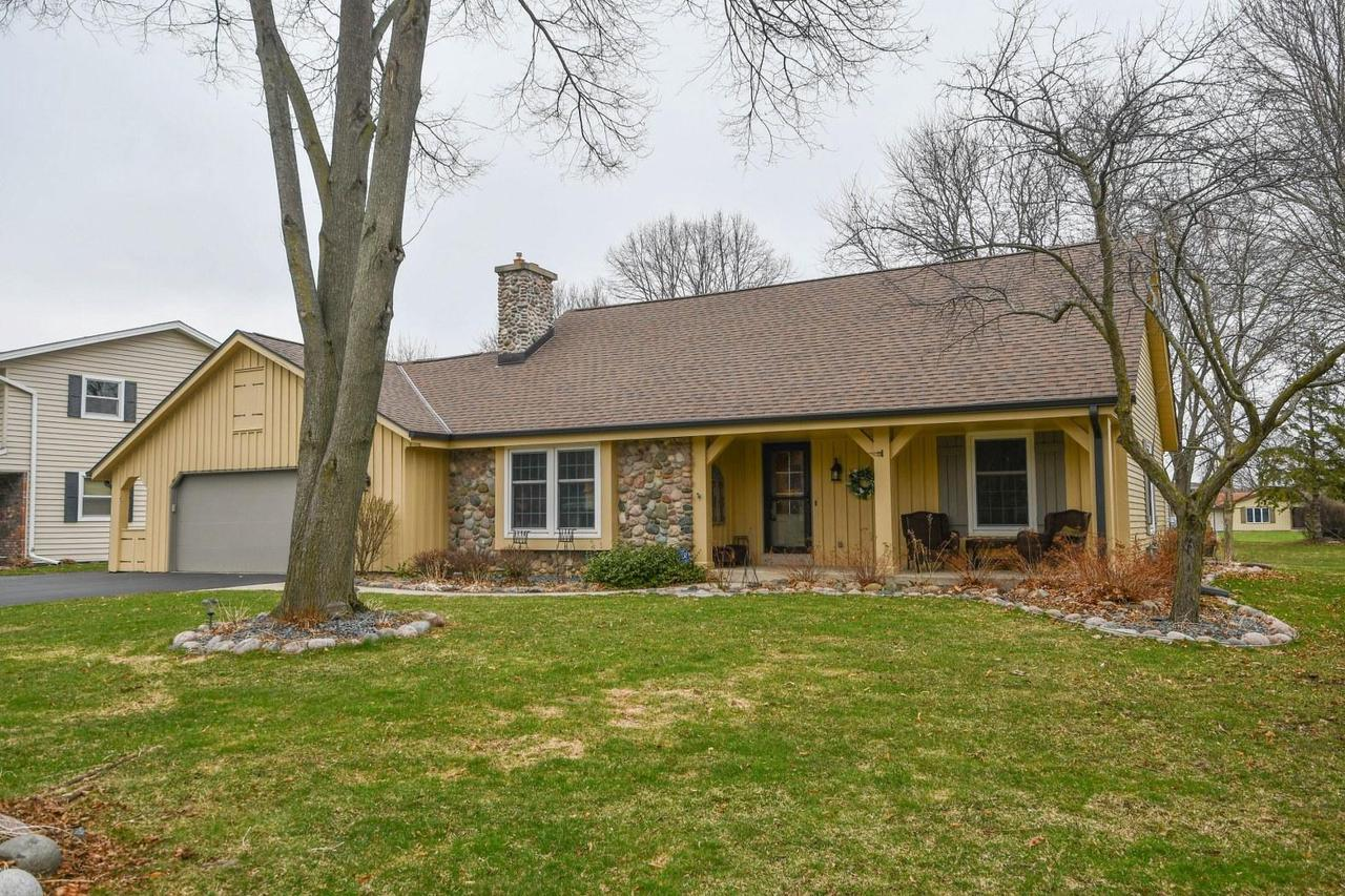 Stunning highly sought after 4 BR, 2.5 BA Cape Cod in popular Springdale Estates Subdivision in low tax Pewaukee! To say this home was updated is an understatement! KIT has newer cabinets, flooring, granite, backsplash, loads of storage, plus a larger eating area, great for a growing family! Newer patio doors open to a brand new oversized low maintenance, cement patio! LR open to KIT offers ease of entertaining! Gorgeous fieldstone gas fireplace! Master BR with WIC and en suite on Main level. Extra half bath on main level for guests. Three good sized bedrooms in upper level, plus additional full bath with newer vanity, toilet and tile floor. Laundry on Main. New roof/ gutters in 2019. New water heater 2019. Super dry basement! A must see! Great home in great area just waiting for new owne