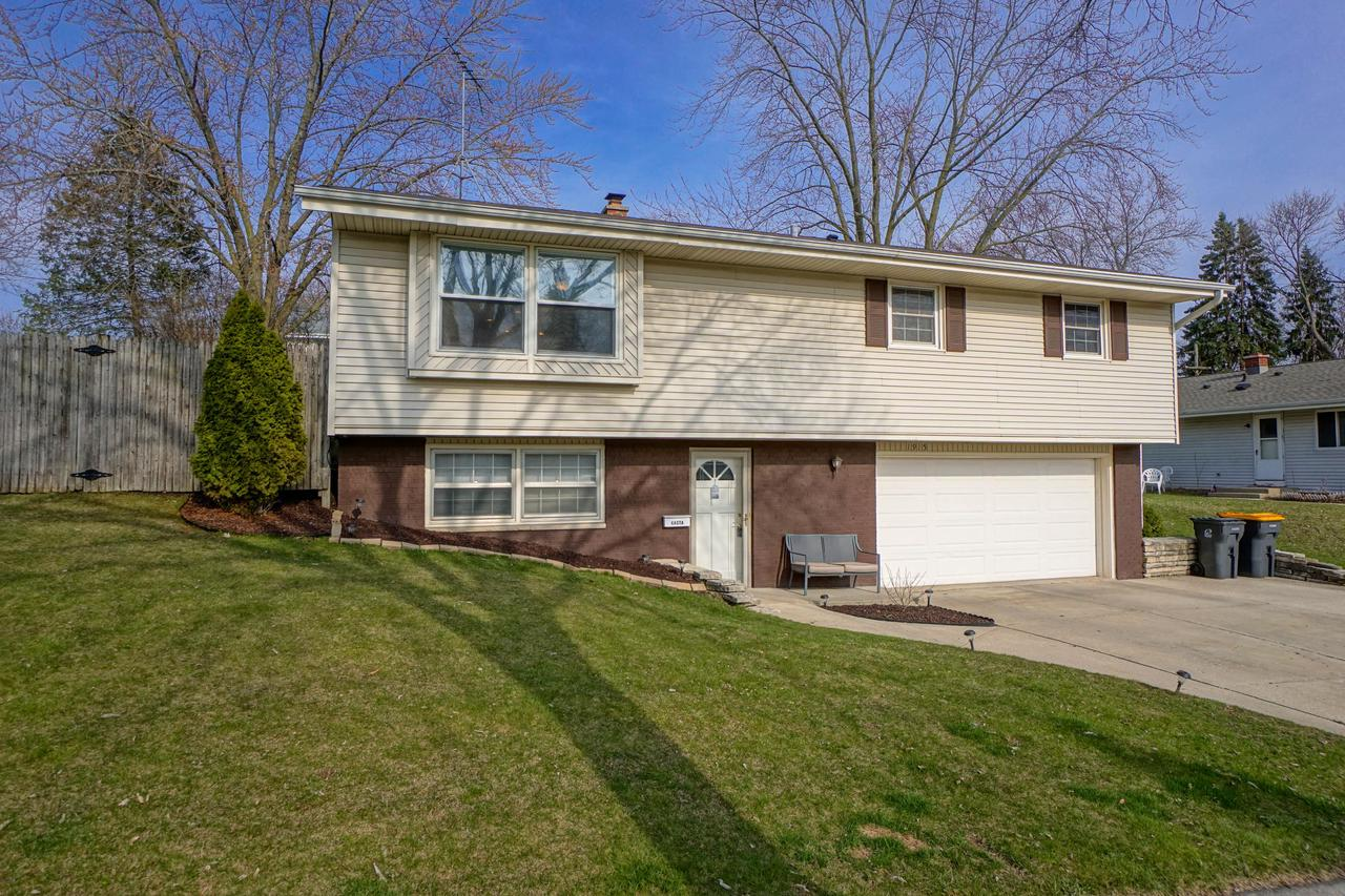 Nicely updated 4BR home in a convenient Waukesha neighborhood! Updated kitchen offers tile floors, granite countertops, soft-close drawers, and SS appliances included. Open dining area and large great room. Hallway leads to 3 nice size bedrooms and full bath. Finished lower level with full size windows has front den or family room, 4th bedroom, and half bath. Attached 2-car garage. Awesome fenced-in back yard with private patio area. Other features include newer windows, 6-panel doors, hardwood flooring, and new A/C.  Great location is close to schools, parks, and all the conveniences!