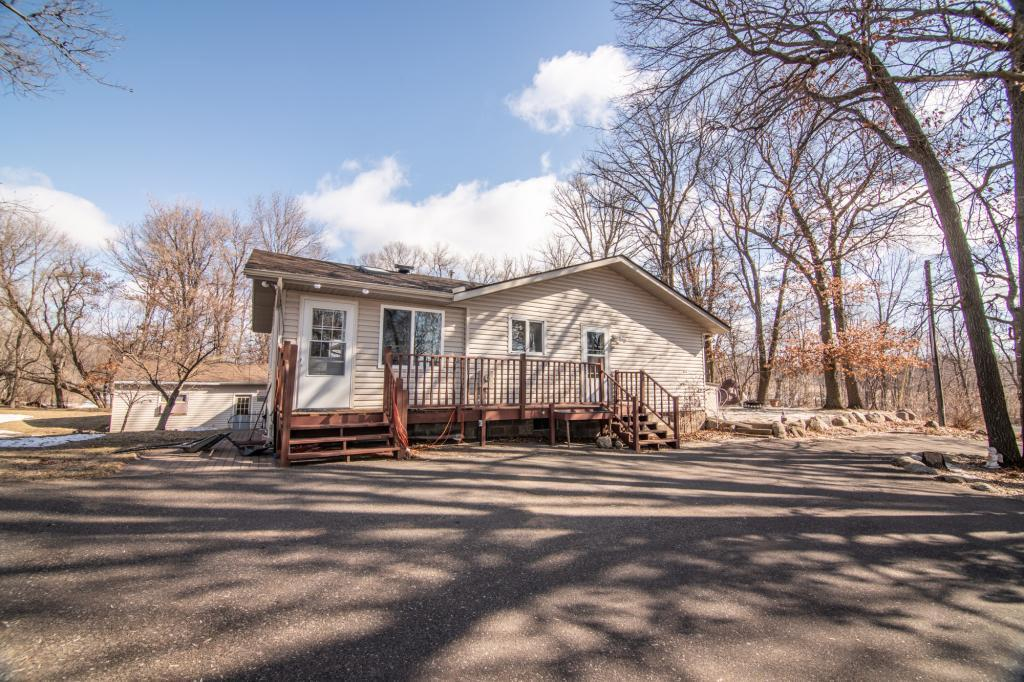 Tons of room to spread out on this property! Close to all the amenities but surrounded by nature! This 3 BR, 3 Bath property is nestled on 1.2 acres. Home boasts a patio for summer time, extensive landscaping, a 3 car garage, heated 18x22 shop with a lean-to(12x22) for storage. Property has asphalt drive way and updates to the home(newer windows and siding, and roof). Home utilizes an elevator for accessibility to the basement, and seller will replace with a set of stairs prior to closing.Basement is partially finished and has a second kitchenette for entertaining/hobbies/etc, and a spacious living room. Multiple options/space for all your hobbies or possibilities for more rooms. If you need space to spread out, this home is for you! Call today for your showing!