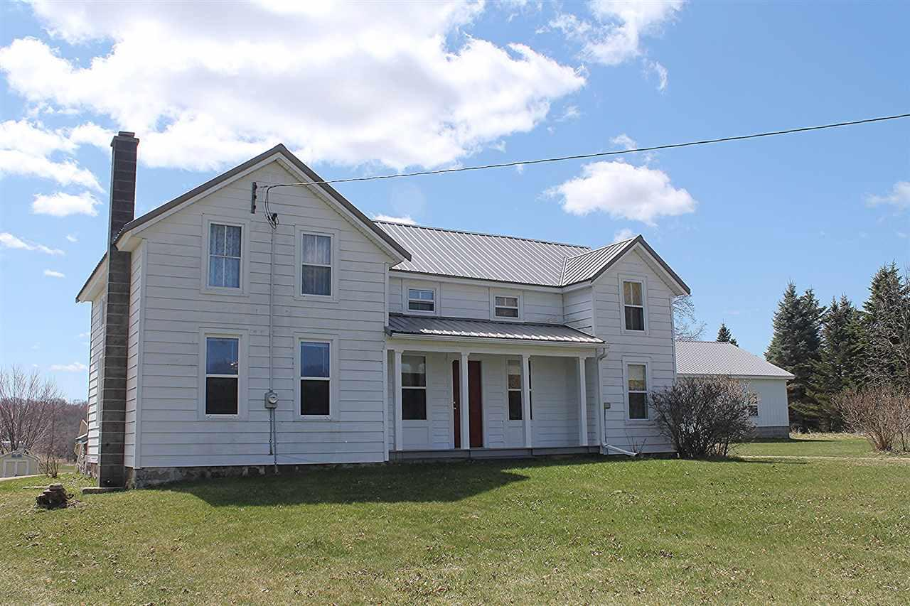 Traditional homestead farmhouse in the heart of John Muir Country.  Situated in the rolling hills of Buffalo Township is this lovingly updated, spacious 2 story country home.  Large, bright open kitchen with good cabinet space,  4 large bedrooms, 2 on the main floor.  Upper level bedrooms feature huge walk in closets, one could easily be partitioned for creating a second bath.  Attached 1 car and detached over-sized 2 car garage for storage.  Traditional milk house could be used as a garden shed.  Great views overlooking the rolling hills of this scenic, quiet area of the county. DSL available through Frontier Communications, buyer to verify.