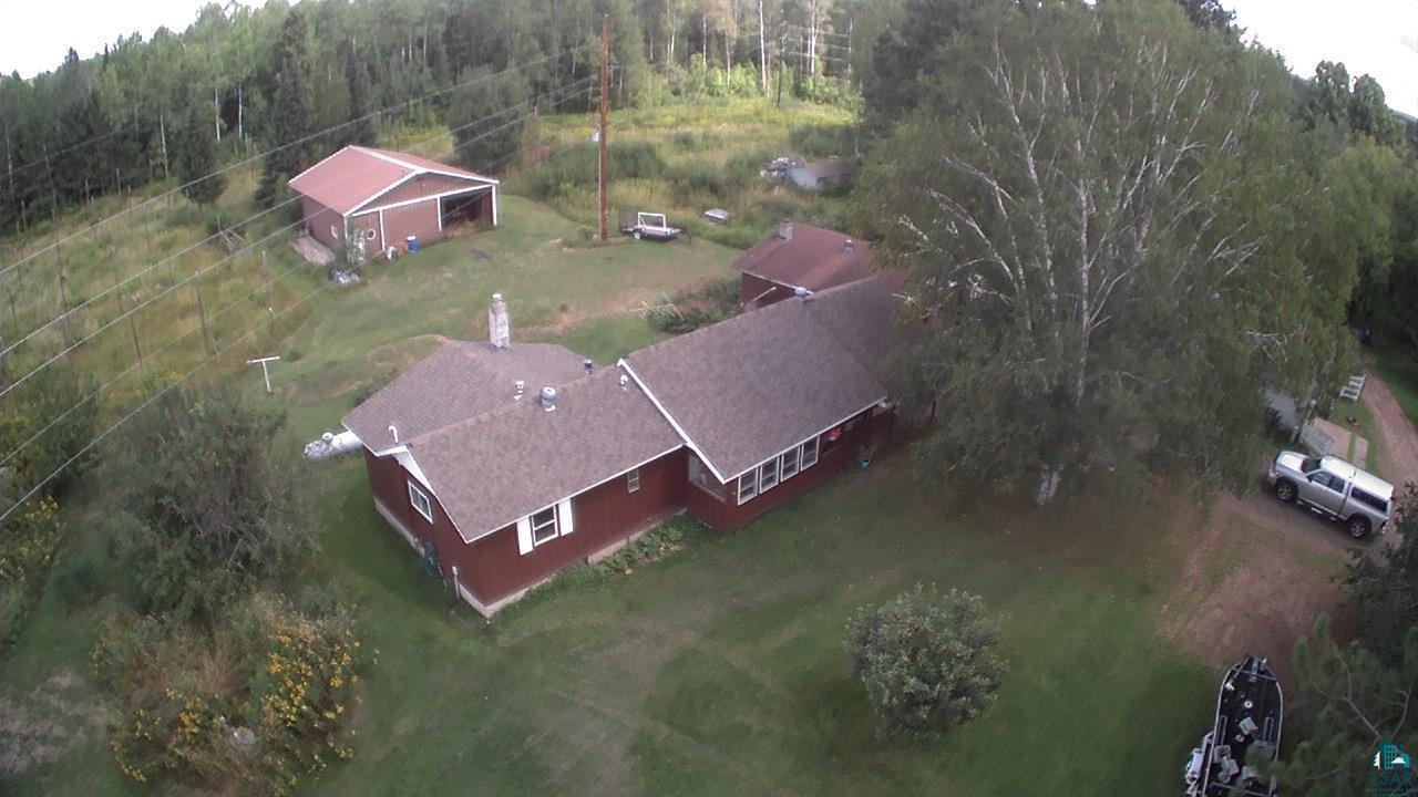 This is a great time to own a home instead of renting!  Why pay rent when your house payment could be less than your monthly rent payment.  Now is the time to build equity in a property that you can call your own!  HOBBY FARM! Thinking about your very own hobby farm? This may be the perfect answer w/spacious barn offering room for horses and all your other pets! This home features a spacious layout with 3 season porch, rear mud/entry room, full basement, large bedrooms and enough space for a large family/rec room all located on 5 acres in the middle of the Brule River State Forest. Your backyard extends right into the forest full of abundant wildlife with hundreds of acres of public hunting/hiking land.  It has easy access to the Tri-County Corridor right from the property.There is a 2-car garage and a 36' x 45' pole barn with a barn room, 2 horse stalls and an additional chicken roosting room complete with nesting boxes. A perfect place for a hobby farm. There are 3 apple trees (2 are honey crisp), and 2 pear trees that produce delicious fruit. There is rhubarb and an asparagus patch and ample space for a large garden that already has rich soil and compost added to it. There is even space to grow corn! There is a 6 foot diameter rock lined fire pit and picnic table included for marshmallow roasts and stargazing next to the campfire. This property was also a working hop farm in the past and still has hops and structure in place for growing your own hops if desired. It is located close to Afterhours Ski Trail and a mile from the Brule River, so much potential for a great family home or hunting/summer getaway.