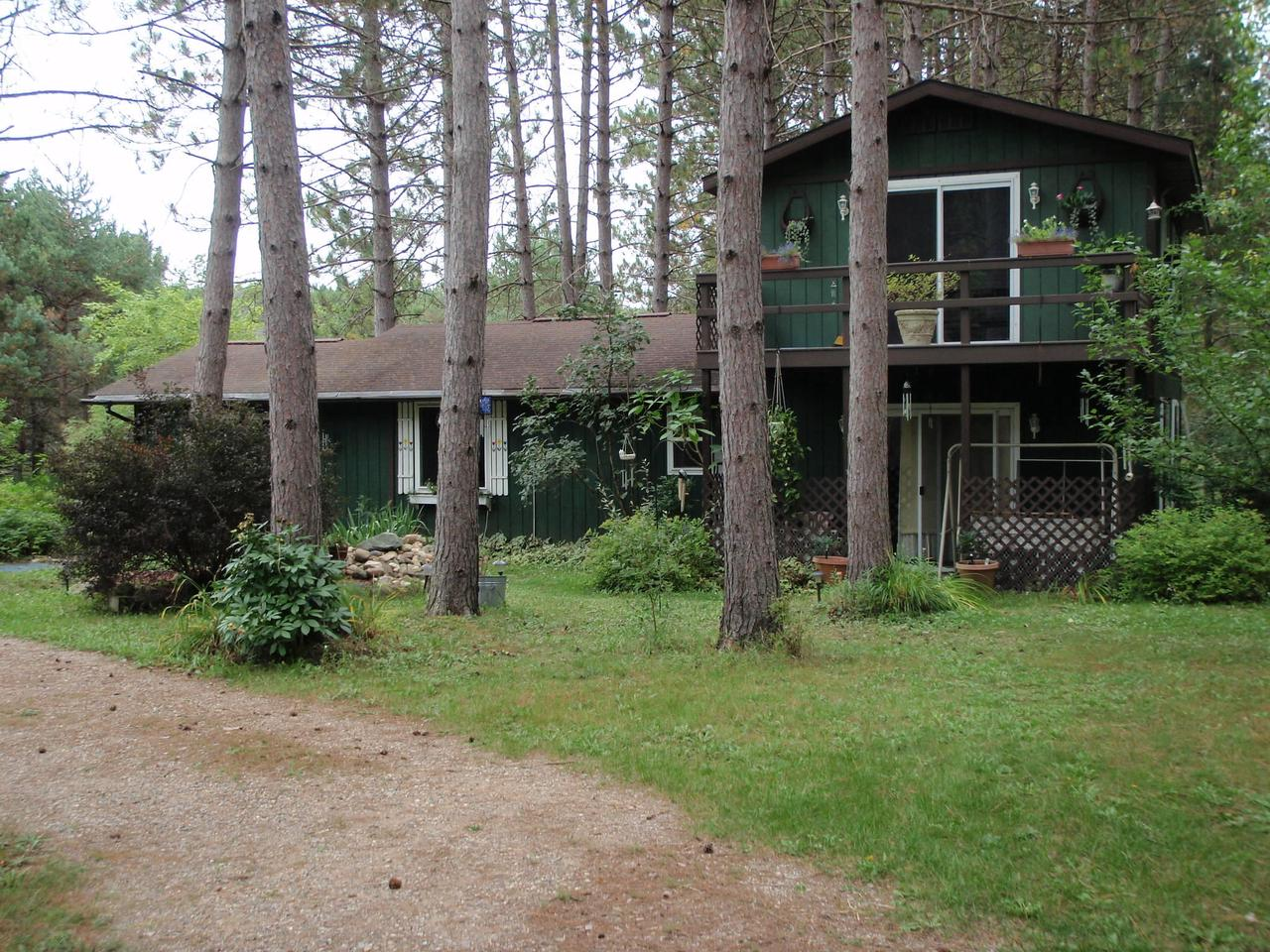 Set in a grove of tall, stately pines, this 2 story, two bedroom cottage is the perfect place to relax & leave behind the cares of the everyday world.  Propane space heaters & electric wall heaters will keep you cozy.  Close to all the North has to offer:  golf, fishing, hunting, trails, etc.  The three-car garage is perfect for all the toys.  Due to the recommendation of social distancing to prevent the spread of COVID-19, this property will not be shown per the seller's request.