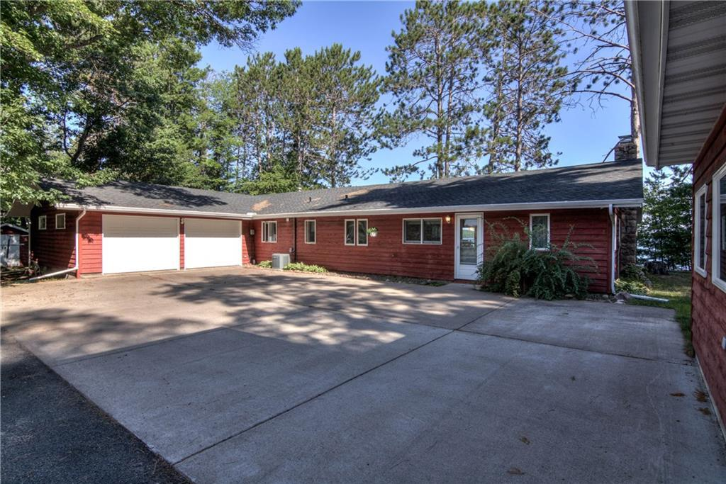 A well-maintained home located on crystal clear Lac Courte Oreilles Lake has just become available and is ready for its new owners. This 3 BR/2 Ba ranch style home offers great privacy on 2 acres with 210? of level sand bottom lakeshore. Lac Courte Oreilles Lake is 5000+ acres and offers great fishing, swimming, and boating with 2 bars/restaurants that are accessible by boat. Plenty of room to entertain all of your guests. Detached garage with finished bonus/rec room above and a pole building to store all of your toys.