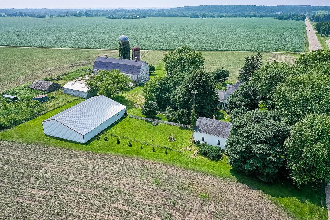 Mark Twain once said, ''Buy Land, they're not making it anymore.'' How true that statement is! Rare opportunity to purchase family farm of 61 years with 160 prime agricultural acres. Approx 140 acres of tillable land and 20 acres of woods. 140 acres are currently rented for $250.00/acre on a year lease. 2 farm houses are on parcel B D 1100007. Main house with 5 BR and the rental house with 3 BR. Plenty of opportunity for additional rental income. There are 3 parcels with this property. Large 102x36 barn, 60x90 machine shed, and several outbuildings for all your storage needs. Act now, never a better time to purchase farm land for the future.  Contact Listing agent for trustee contingency which has to be written into all offers.