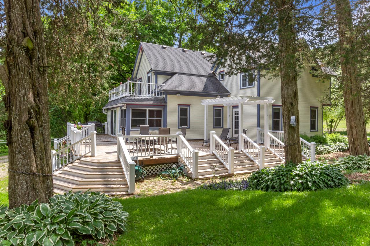 This storybook 4 Bed 2 Bath UPDATED Victorian farmette sits on almost 5 acres yet still maintains the charm & quality of its unique architectural period with all it's modern day conveniences. Beautiful custom white cabinets adorn this spacious bright kitchen that opens to sitting area w/gas fireplace overlooking beautiful acreage w/ Pond Views. Appointed w/custom baths, large dining area w/original built-in breakfront & leaded glass cabinet doors, 5 panel solid wood doors w/beautiful wide trim & hardwood floors, cozy living room w/sun filled bay window & 1st floor bedroom w/door to deck. Relax on your screened front porch or soak up the sun on your 1200 sf wrap around deck. So many original features. 36 x 62 Barn. Equestrian Friendly! Updates and Features in doc. drawer