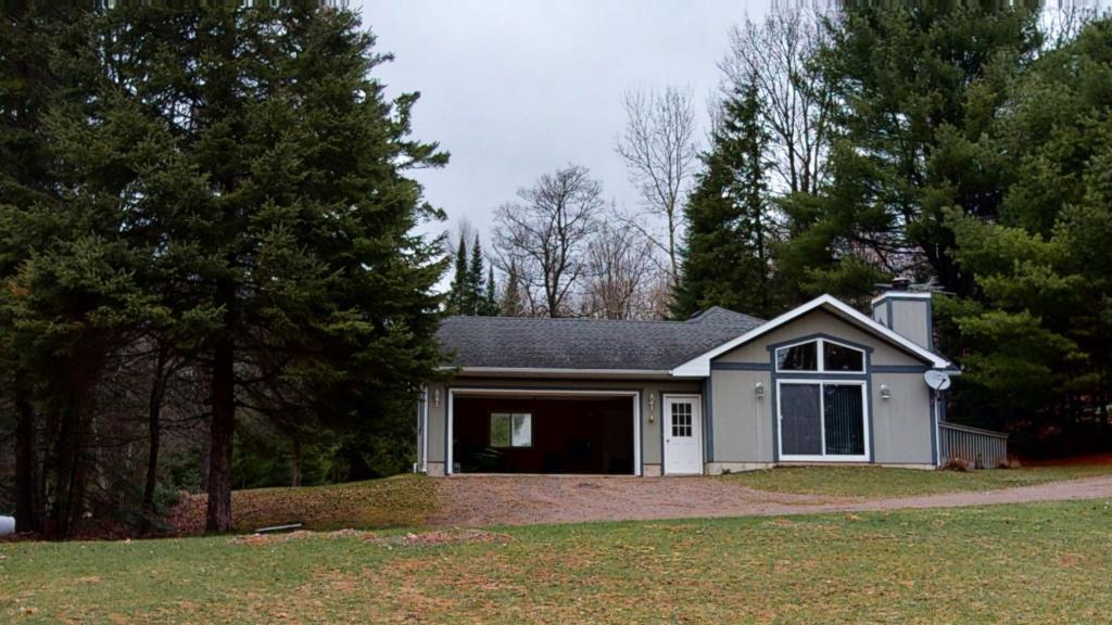 A welcoming cabin on 2+ acres and 108? frontage on sedate Blaisdell Lake. This property features 2 bedrooms and one bath. Livingroom features a  warm & welcoming fieldstone fireplace with patio doors leading a deck.  Open concept kitchen/dining and livingroom. Family room has knotty pine walls and a wood stove also has attached deck. (could be used as a 3rd bedroom)  Attached 2 car garage and a boathouse. An excellent recreational headquarters as it offers ATV/snowmobile travel, boating and kayaking.  Blaisdell Lake is a 341 acre lake with Musky, Panfish, Largemouth Bass, Smallmouth Bass, Northern Pike and Walleye