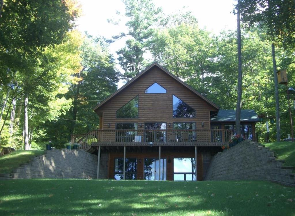 "Enjoy Amazing Western Sunsets from your deck or inside the comfort of this Beautiful Chalet-style Walk-Out. This cozy spot is located on 805 acre (Class A Musky, Sissabagama Lake. This home was built with high quality craftsmanship and has been well maintained. Honeywell Whole House Dehumidifier, ADT, New Refrigerator, Bosch Dishwasher, 3/4"" Hickory Hardwood Flooring, Douglas fur Interior Doors, Hickory Slider Kitchen Cabinets with Granite Counter-tops. Over-sized walk-in closet master bed. 4-car cold storage with concrete (32x40) garage, and a (28x30) insulated 2-car garage. Spectrum 100MB High Speed Internet, and Charter Cable TV (New roofs on all 3 buildings, new furnace, new refrigerator, new A/C Unit)"